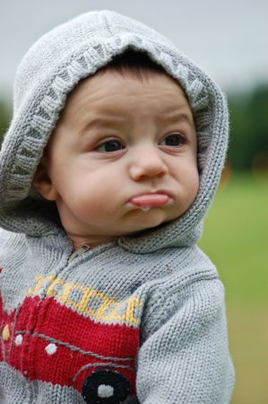 Cute caucasian toddler in a hoodie drooling slightly Stock Photo