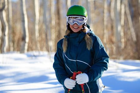 Young female skier outdoors on a sunny day photo