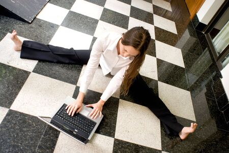 Woman on the floor working on her laptop Stock Photo - 2687863