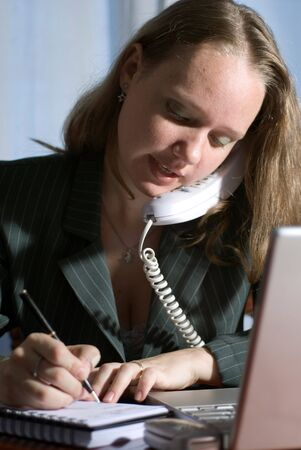 Woman in a business suit on the phone photo