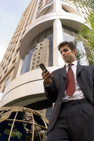 Business man looking at his cell phone photo