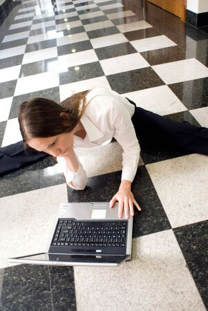 Woman on the floor working on her laptop Stock Photo - 2688316