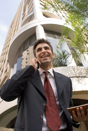 Male in a business suit on his cell phone photo