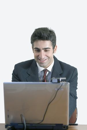 Business man at laptop with a contented smile photo