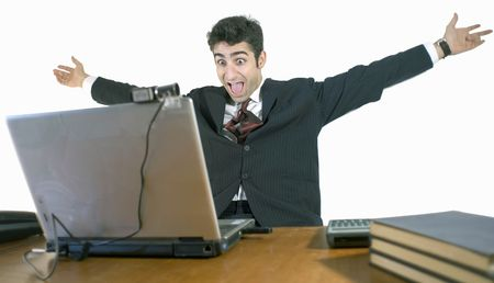 Business man with his arms outstretched sitting at this laptop. Isolated against a white background photo