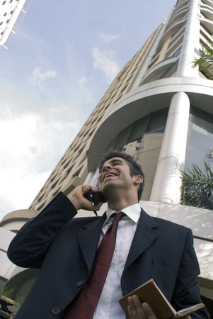 Business man on the phone, smiling and chatting photo