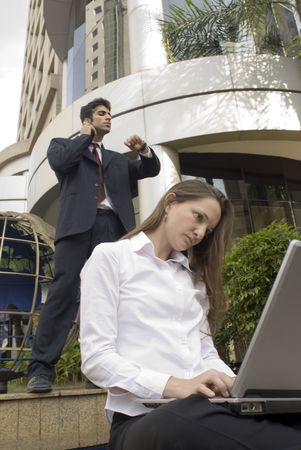 Man and woman in business attire working together photo