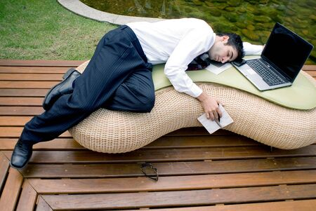 Man in business attire asleep in front of his laptop Stock Photo - 2739757