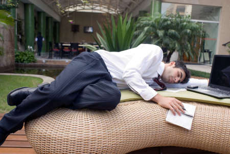 sprawled: Man in business attire sprawled out in front of his laptop