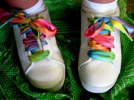 Shot of white sneakers with colorful laces. Stock Photo - 2739749