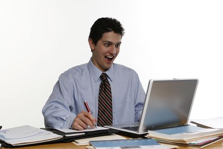 agape: Business man with his mouth open in amazement staring at his laptop