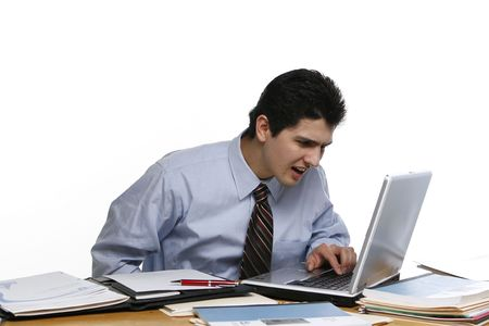 leaning forward: Business man leaning forward and squinting at his laptop screen