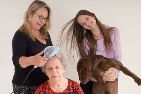 three generations of women: Three generations of women (and a puppy) in one photo. Mother is drying the grandmothers hair