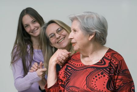 three generations of women: A shot of three generations of women (daughter, mother, grandmother) holding hands. Stock Photo
