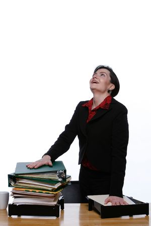 Businesswoman with her hand on a big pile of folders in her outbox. Stock Photo - 2986982