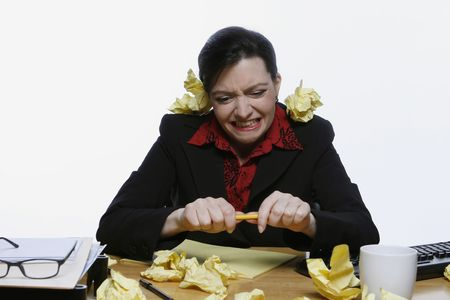 Woman in a business suit balancing a pencil under her nose surrounded by crumpled up pieces of yellow paper. Isolated against a white background photo