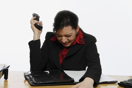 Businesswoman banging her phone against her head with a look of anguish on her face. Isolated against a white background. Stock Photo - 3002592