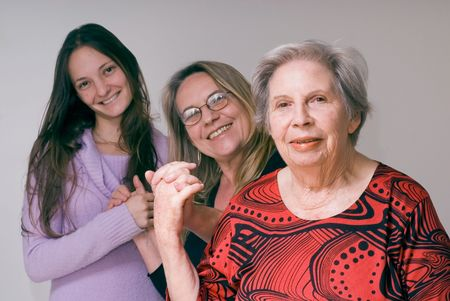 A shot of three generations of women (daughter, mother, grandmother) holding hands. 版權商用圖片