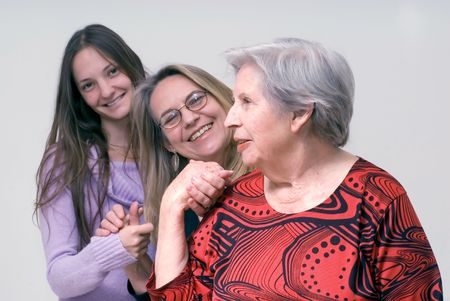 A shot of three generations of women (daughter, mother, grandmother) holding hands. Stock Photo - 3002700