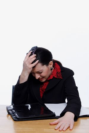 banging: Businesswoman banging her phone against her head with a look of anguish on her face. Isolated against a white background.