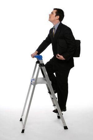 white work: Businessman with his briefcase clutched under one arm climbing  up a stepladder with his gaze focused on the ceiling. Isolated against a white background