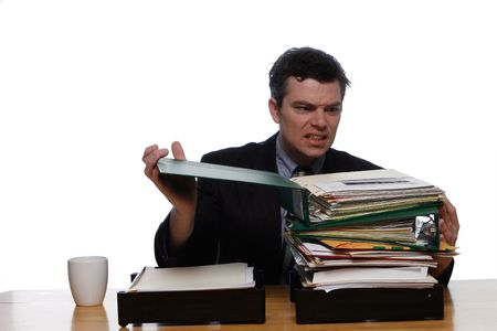 swamped: An isolated shot, on white, of a businessman opening a stack of paper work.  Hes visibly upset.