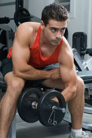 curls: A shot of a male weightlifter doing a bicep curl with a barbell. Stock Photo