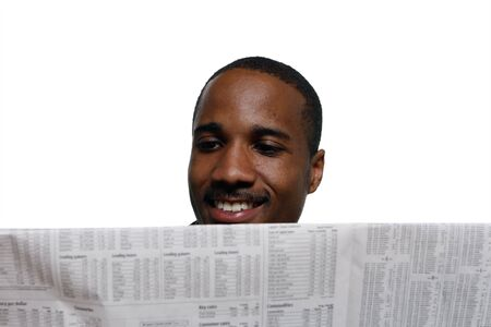Man smiling while reading the paper. Horizontal shot, isolated against a white background photo
