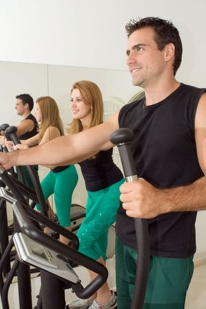Close cropped shot of a young, attractive couple working out at the gym together Stock Photo