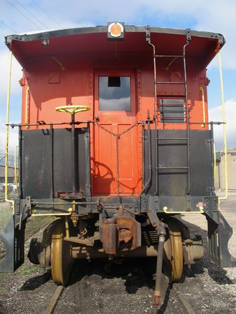caboose: Old red train caboose on a train track. Stock Photo