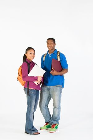 Two teens look ready for school with their backpacks, and notebooks. Vertically framed photograph 写真素材