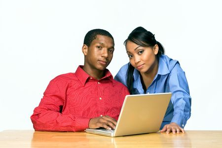 Two Teens Looking seus as they stare ahead and he holds a Laptop Computer. Horizontally framed photograph Stock Photo - 3196819