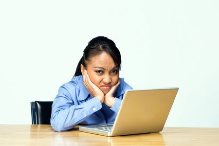 uninterested: Female student appears frustrated as she frowns at the camera. Horizontally framed photograph. Stock Photo