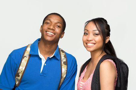 african student: Due studenti di indossare zaini sono ridendo. Orizzontalmente foto incorniciata  Archivio Fotografico