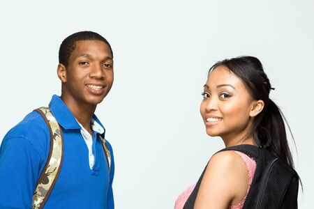 study group: Two students wearing backpacks look at the camera and smile. Horizontally framed photograph Stock Photo