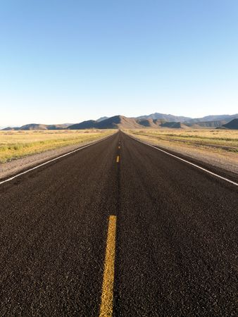 Close-up of vacant road. Mountainous background. Vertically framed shot. Stock Photo - 3271263