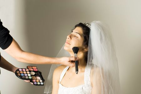 bore: An engaged woman, closes her eyes while her face make-up is being done. - horizontally framed Stock Photo