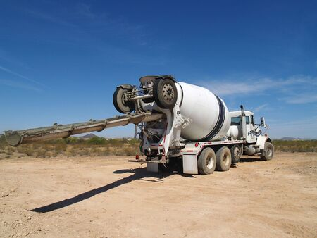 A cement truck is parked on an excavation site.  Horizontally framed shot. Stock Photo - 3338969