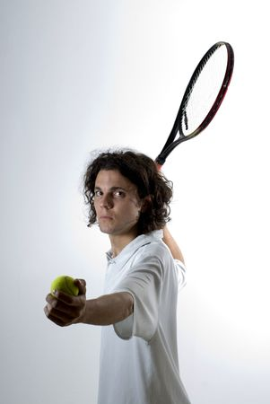 bore: A young man, holds a tennis racket back and a ball forward, getting ready to serve the ball. He stares at the camera. Vertically framed shot.