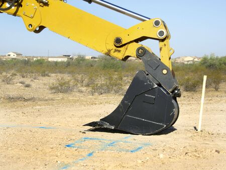 A giant steam shovel is leaning on the ground.  Horizontally framed shot. Stock Photo