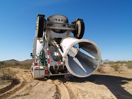 A cement mixing truck is parked in the desert. Horizontally framed shot. 写真素材