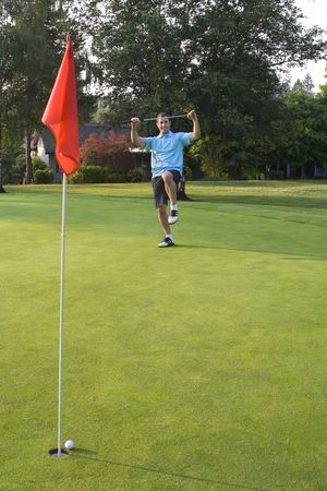 Man about to break his putter after missing - Vertically framed shot. Archivio Fotografico