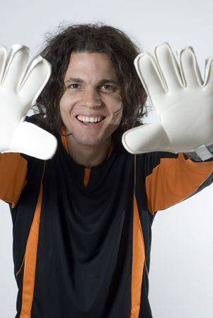 vertically: Soccer goalie smiles as he holds his hands up.  Vertically framed photograph Stock Photo