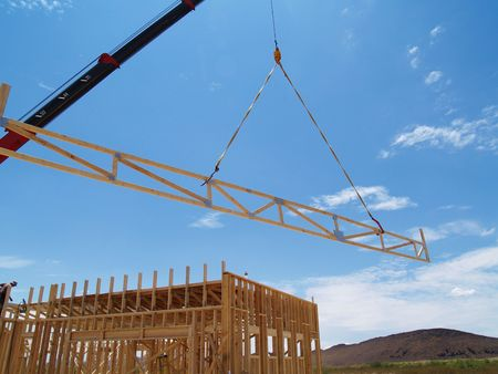Construction site with a  frame and a crane. Horizontally framed photo.