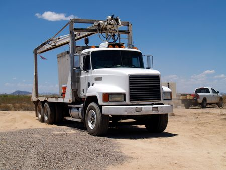 Mack truck at a construction site with a smaller work truck in the background. Horizontally framed photo. Stock Photo - 3443010