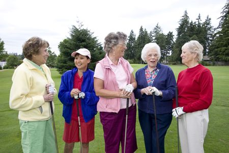 Five elderly women holding their golf clubs.  Horizontally framed photo. photo