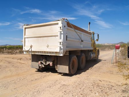 A dump truck is parked in a desert excavation area.  Horizontally framed shot. Stock Photo - 3881942