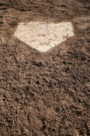 A view of home plate on a baseball diamond. Horizontally framed shot.