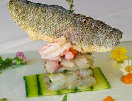 very elegant fish dish service of haute cuisine
