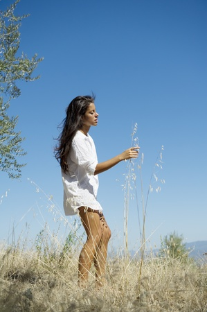 Young woman freely through the meadows